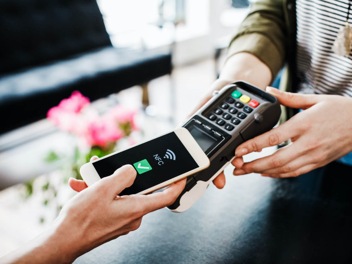 person using a mobile phone for payment