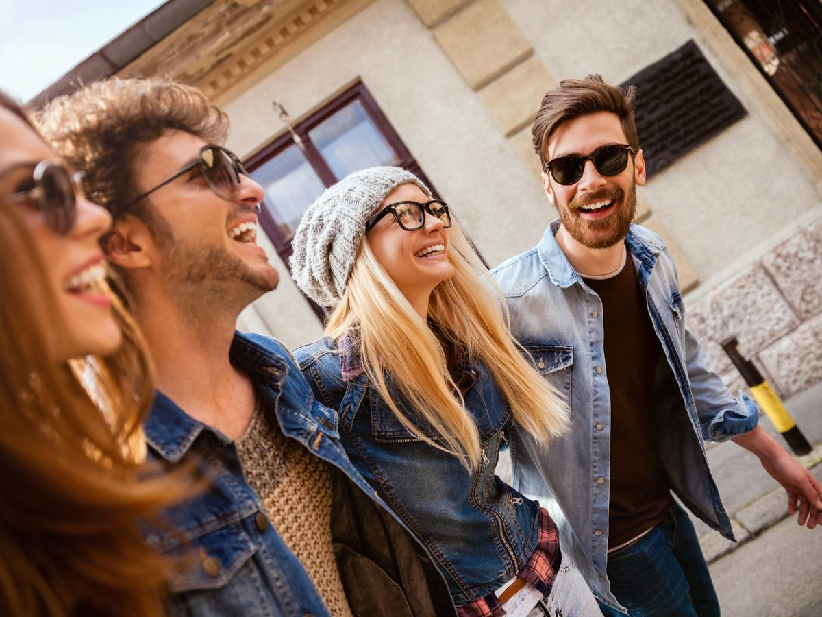 Friends out for a walk wearing glasses and sunglasses