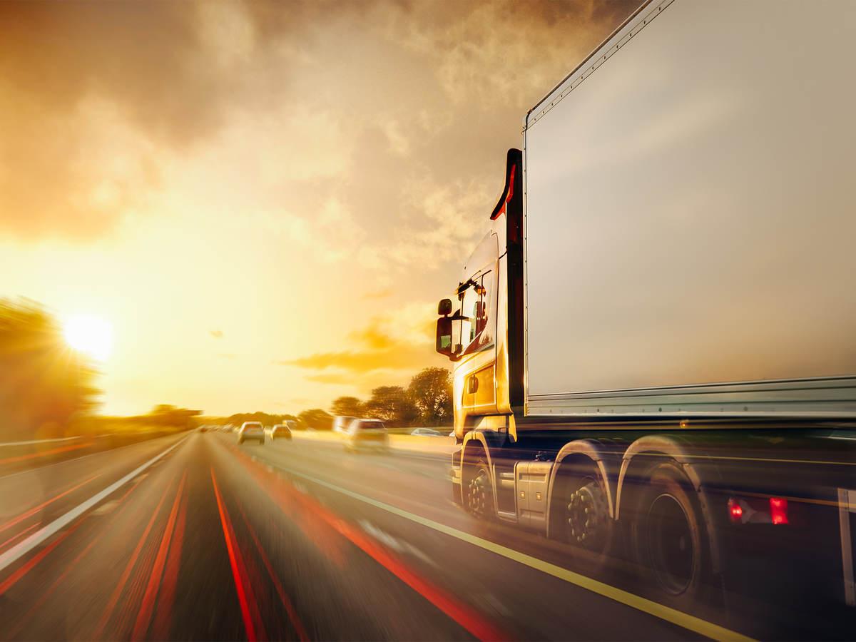 Truck traffic transport on highway in motion