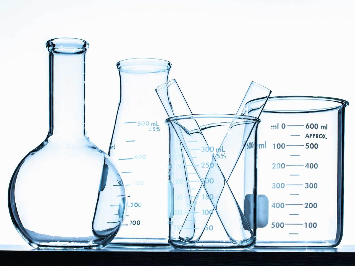 several empty glass beakers in a row