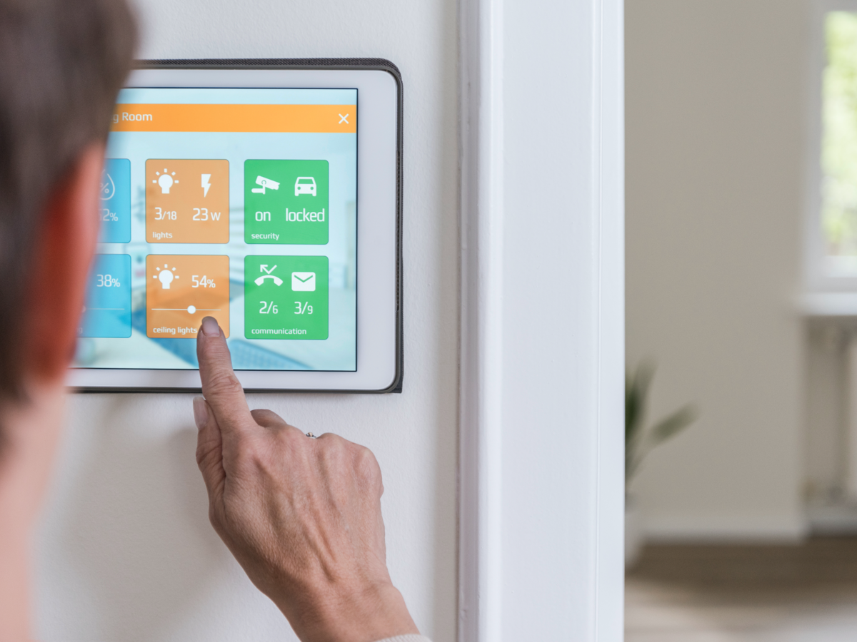 Woman using smart home control screen