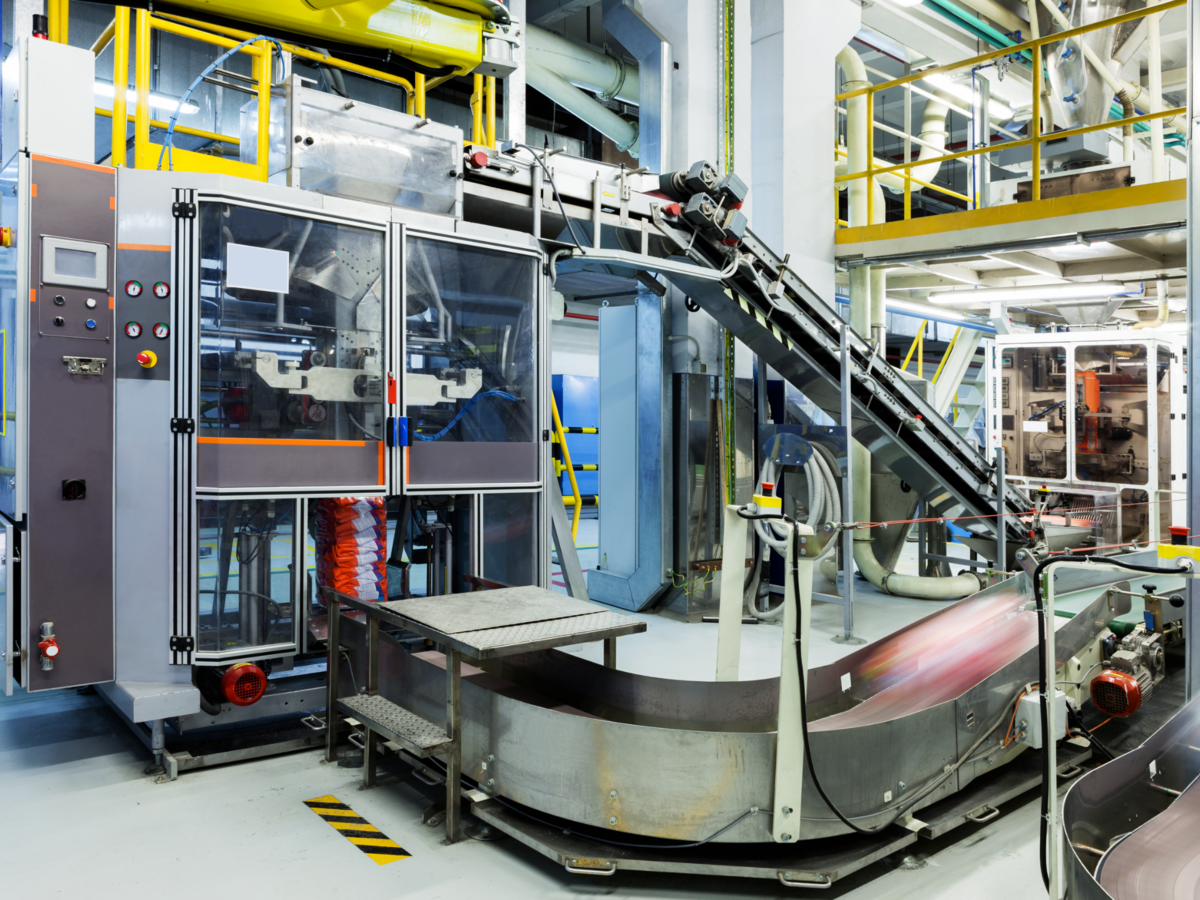 Industrial machinery and systems at a manufacturing facility