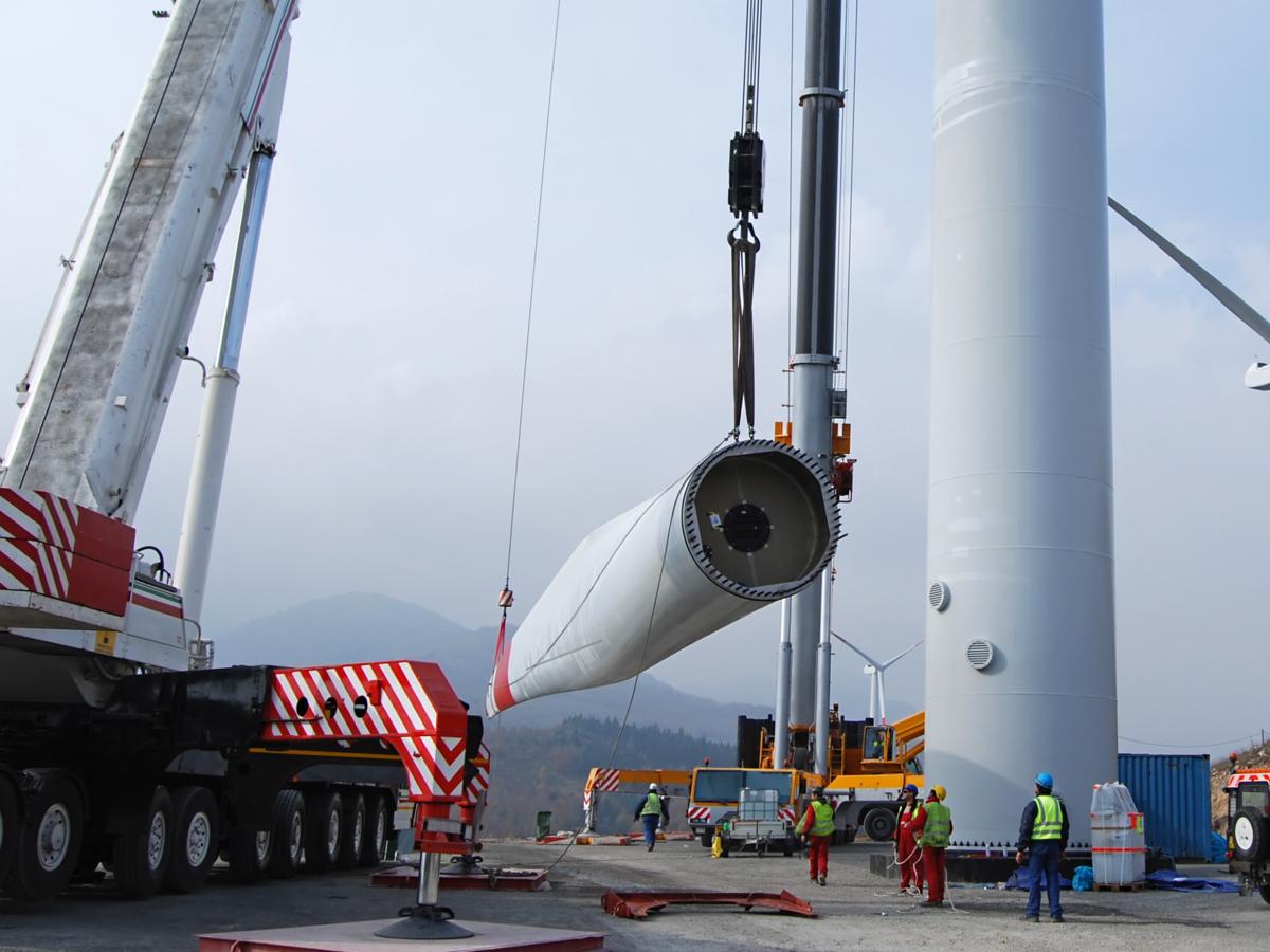 Workers doing wind turbine maintenance