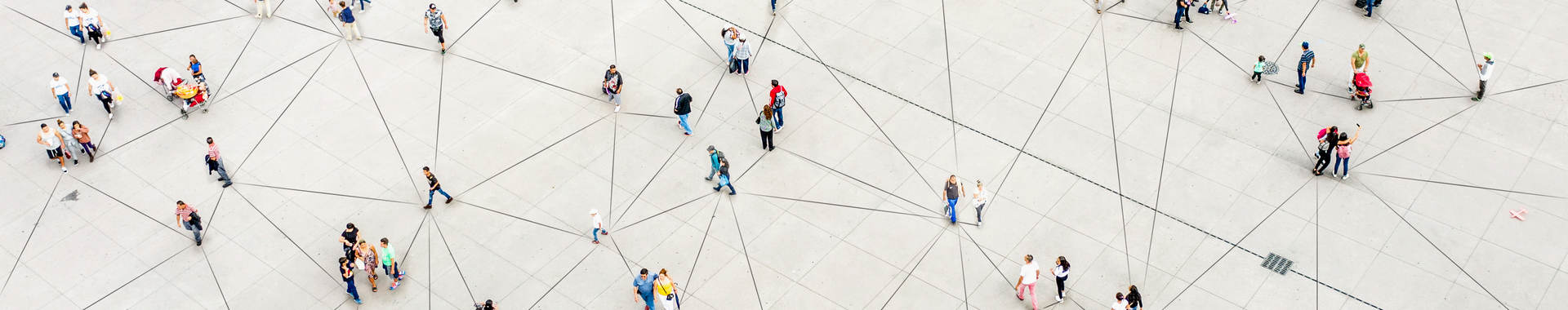 Groups of people standing being connected by lines on the ground.