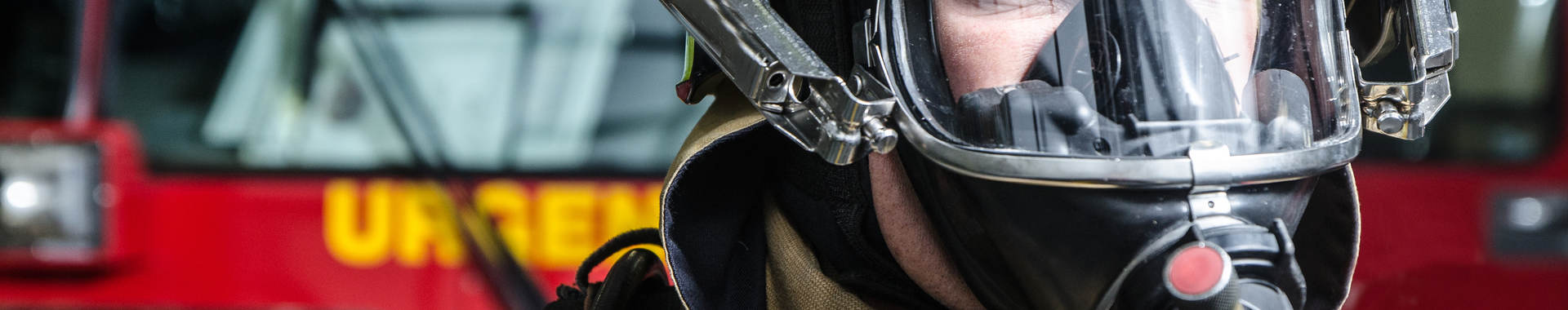 Fireman with breathing mask close up