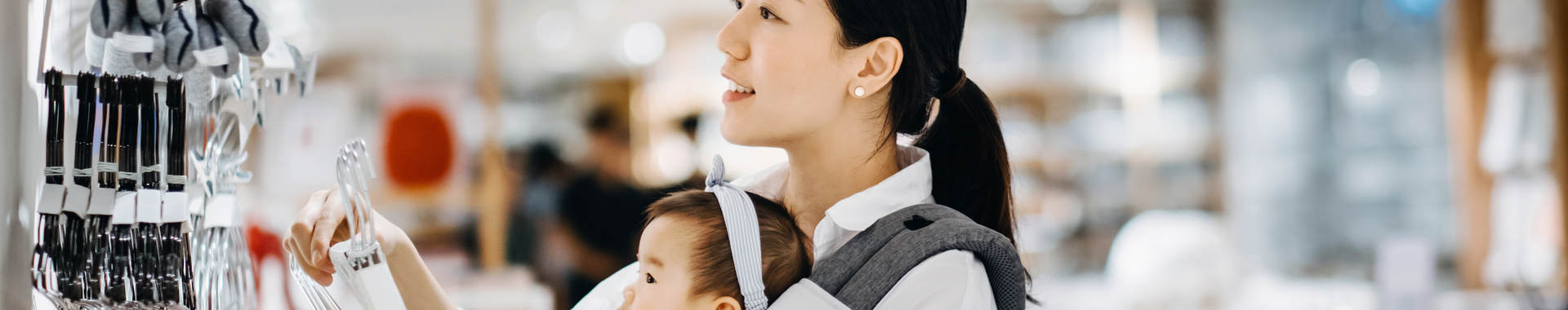Asian women with baby shopping at department store
