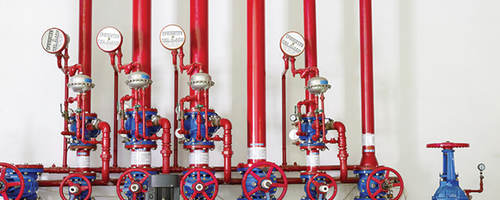 Red pumps and valves in a fire station.