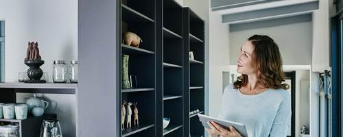 Woman on smart device in smart home