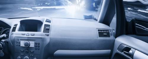 The passenger view of someone riding in a car