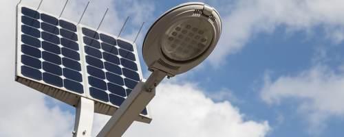 Solar power streetlights against blue sky